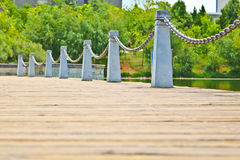 Pillar and chain fence down on a lake side. In Kunming Royalty Free Stock Image