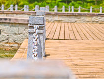 Pillar and chain fence down on a lake side. In Kunming Stock Photo