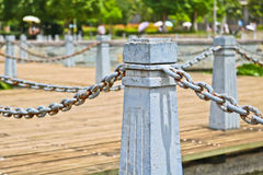 Pillar and chain fence down on a lake side. In Kunming Royalty Free Stock Images