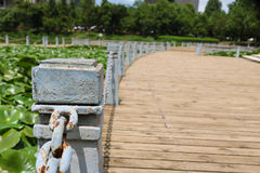Pillar and chain fence down on a lake side. Kunming Royalty Free Stock Image