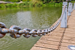 Pillar and chain fence down on a lake side. Kunming Royalty Free Stock Photos
