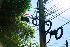Pillar electric line in sun light Royalty Free Stock Photography