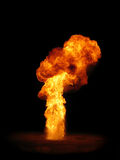 Pillar of fire. From an exploding wax bomb against a black background Royalty Free Stock Photography