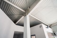 Pillar inside an industrial hall Stock Images