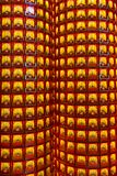 Pillar with many small goddess statues in chinese temple Royalty Free Stock Images