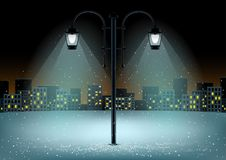 Pillar night city background. Electric pillar and falling snow in lamps lights. Christmas snowflakes falls on night city background Stock Images