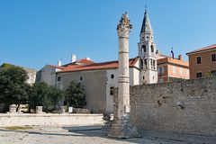 The Pillar of Shame and St Elias`s Church, in Zadar Old Town, Croatia. stock images