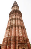 A pillar structure in Qutub Minar complex with Calligraphy and intricate desig Stock Image