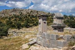 Pillar tomb Stock Images