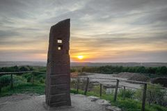 Pillar on top of hill at sunset stock photography