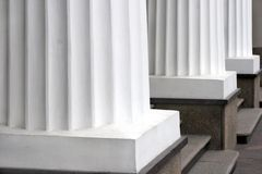 Pillars. Three classical white greek columns in a row Royalty Free Stock Photography