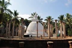 Pillars and Ambasthala Stupa Mihintale, Sri Lanka. Circle of ancient pillars and white washed Ambasthala stupa at Mihintale, Sri Lanka Stock Images