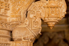 Pillars with ancient carvings of stone sanctuary in Jain temples, India. Royalty Free Stock Photos
