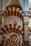 Pillars and arches inside the Mosque church of Cordoba, Spain, E. Arches and pillars inside the Mosque-Cathedral of Cordoba,Mezquita de Córdoba,the Great Mosque Stock Image