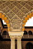 Pillars and arches in the patio. The Alcázar of Seville is a royal palace in Seville, Spain, originally a Moorish fort Stock Photo