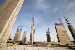 Pillars of a building in the making against blue sky royalty free stock photography