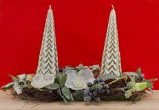Pillars candle with  christmas decoration against red background Royalty Free Stock Photo