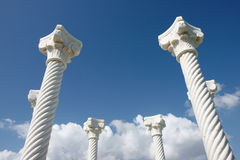 Pillars / Columns. White columns in blue background of sky with nice white clouds royalty free stock photography