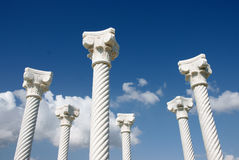 Pillars / Columns. White columns in blue background of sky with nice white clouds stock image