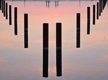 Pillars at dawn. Pillars in water Stock Photos