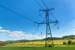 Pillars of high voltage in the Czech landscape. Electricity distribution. Royalty Free Stock Images