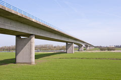 Pillars of highway bridge over river Stock Photography