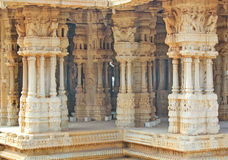 Pillars inside a hindu temple at Hampi, India. Hampi, the former capital of Vijayanagara Empire, whose powerful ruler,Sri Krishnadevaraya is very known in Indian Stock Photo
