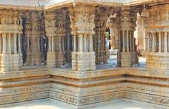 Pillars inside a hindu temple at Hampi, India Stock Photos