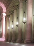 Pillars with lamps. Hanging in between them historic building nice background picture Stock Photos