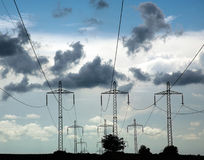 Pillars of line power electricity on background blue sky Stock Photo