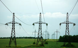 Pillars of line power electricity on green field Stock Image