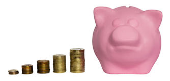 Pillars of the money before the pink piggy bank royalty free stock photo