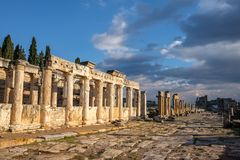 Pillars on a road in Hierapolis, Pamukkale, Turkey during sunset royalty free stock photos