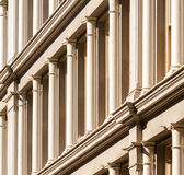 Pillars. A row of pillars in the facade of a house Royalty Free Stock Photos