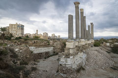 Pillars in the ruins with dramatic cloudscape with mosque in Tyre, Sour, Lebanon Stock Photography