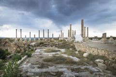 Pillars in the ruins with dramatic cloudscape in Tyre, Sour, Lebanon Royalty Free Stock Image