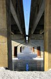 Pillars under bridge Royalty Free Stock Images