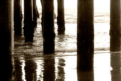 Pillars under the pier Stock Image