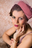 Pillbox hat on vintage lady. Vintage 1920s woman wearing a pink pillbox hat royalty free stock image