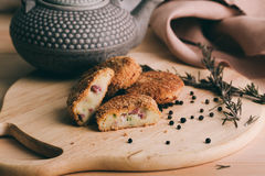 Pille of crispy homemade baked fast food potatoes nuggets with chicken shrimp and cheese Stock Photography
