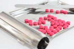 Pille, die Tellersegment zählt Stockfotos