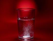 Pille in einem Glas Lizenzfreie Stockbilder