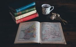 Pilled Books Near White Ceramic Mug on Brown Wooden Surface Stock Images