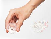 Pillen in de hand Royalty-vrije Stock Afbeelding