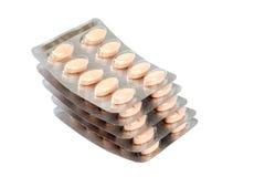 Pillen in den Blisterpackungen auf weißem Hintergrund Lizenzfreie Stockfotografie
