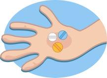 Pillen in der Hand Stockfotos