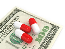 Pillen, die 100 Dollarscheine sind Stockbild