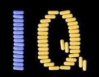 Pillen, die IQ buchstabieren Stockbild