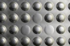 Pillen in een blaar voor de achtergrond stock foto's