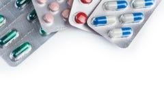 Pillen en capsules op witte achtergrond Royalty-vrije Stock Fotografie